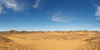 Vast Valley in the Akakus Mountains, Sahara, Libya. Panorama of a vast valley in the Akakus Mountains, Sahara Desert, Libya Royalty Free Stock Photo