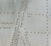 Vastgenageld metaal van vliegtuigen stock foto's