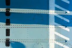 Vastgenageld metaal van vliegtuigen stock afbeeldingen
