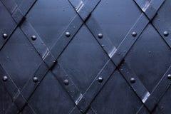 Vastgenageld zwart metaal royalty-vrije stock afbeelding
