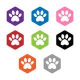 Vastgesteld vector hexagon vormpictogram met de dieren Geïsoleerde de pictogrammen van de kattenpoot dierlijke hexagonale voetafd stock afbeeldingen