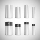 Vastgestelde standaardgroottebatterijen op een schaal Stock Foto's