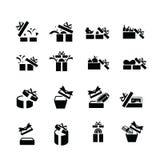 Vastgestelde zwarte giftpictogrammen, open giftdoos Royalty-vrije Stock Afbeeldingen