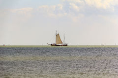 In the vastness of Markermeer. It's sailing fishing boat on Lake-Bay Markermeer in the Netherlands in late spring Stock Image