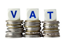VAT. Stacks of coins with the letters VAT isolated on white background Royalty Free Stock Photography