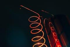 Vat och metallisk spiral av exponerat rött för alkoholmaskin arkivfoton