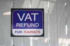 Vat refund for tourists information board sign at international airport. Vat refund for tourists information board sign with red and white character on blue Stock Image