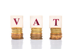 VAT or Value Added Tax concept with stack of coin stock images