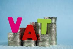 VAT (Value Added Tax) concept. Word VAT alphabet made from wood royalty free stock images