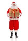 Vater Christmas, das ein Geschenk eingewickeltes Geschenk hält Lizenzfreie Stockbilder
