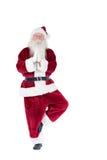 Vater Christmas, das etwas Yoga tut Stockfoto