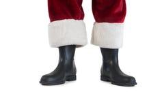 Vater-Christmas-Stiefel und -beine lizenzfreie stockbilder