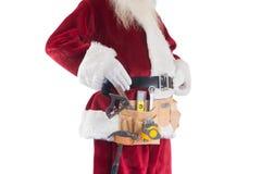 Vater Christmas trägt einen Werkzeuggurt Stockbild