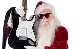 Vater Christmas zeigt eine Gitarre Lizenzfreies Stockfoto