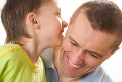 Vater, der mit seinem Sohn spricht Stockbilder