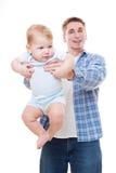 Vater, der seinen Sohn anhält Stockbilder