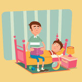 Vater liest ein Buch zu seinem Sohn für eine gute Nacht Lizenzfreie Stockbilder