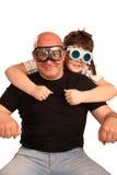 Vater und Sohn, die in den Motorradfahrern spielen Stockfotos