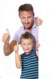 Vater- und Sohnausdruck Stockfotos