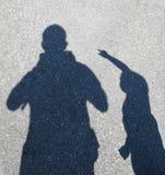 Vater- und Sohnschatten Stockfoto