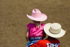 Vater und Tochter am Rodeo Stockfoto