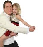 Vater- und Tochtertanzen innen Stockbild