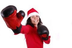 Vaterweihnachten unter Verwendung der Verpackenhandschuhe Lizenzfreie Stockbilder