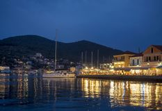 Vathi by night. Many tavernas with fresh fishes and traditional food. Ithaka is a lovely peaceful little island in Ionian sea with beautiful beaches stock images