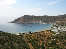Vathy Bay, Sifnos island. The beautiful vacation bay of Vathy, Sifnos island, Greece; yachts are anchored in the bay, and a pool of an expensive hotel can be royalty free stock images