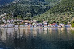 Vathy Ithaca in the Ionian Sea. Vathy the town in Ithaca island in the Ionian Sea in Greece.View across the harbour with traditional houses. Daytime Stock Image