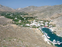 Vathys, Kalymnos. The little village and port of Vathys, Kalymnos island, Greece, on the tip of a deep fjord-like bay stock photo