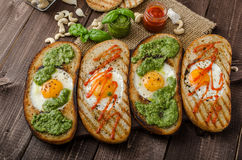 Vatiations of fried eggs inside bread Royalty Free Stock Image