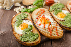 Vatiations of fried eggs inside bread Stock Image