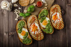 Vatiations of fried eggs inside bread Stock Photography