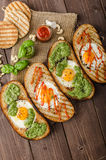 Vatiations of fried eggs inside bread Stock Photo