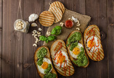 Vatiations of fried eggs inside bread Royalty Free Stock Photo