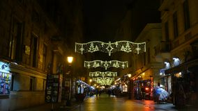 Vatica street Budapest. Vatica street in Budapest with many souvernir shops and hungarian restaurants by night stock video footage