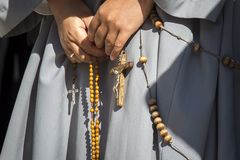 A religious prays the holy rosary royalty free stock photos
