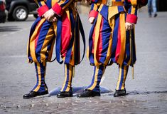 Swiss Papal Guards of Vatican. Vatican City, August 13, 2012: The Pontifical Papal Swiss Guards in service as guardians of Pope at Vatican City royalty free stock photo