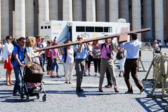 Vatican city center life - pilgrims carry cross. ROME, ITALY - MAY 30: Vatican city center life - pilgrims carry cross on May 30, 2014, Rome, Italy Stock Photography