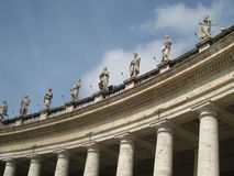 Vatican City Colonnades. The Colossal Tuscan colonnades with statues that frame the entrance to St. Peter`s Square and its basilica. Vatican City, Rome, Italy Royalty Free Stock Images