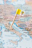 Vatican city flag pin on a country map. Paper flag pin of Vatican City State on a country map. It is is a sovereign state located within the city of Rome Stock Photos