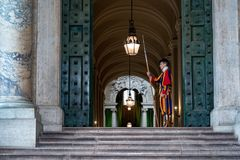 VATICAN CITY, ITALY - JUNE 8, 2018 : A member of the Pontifical Swiss Guard, Vatican. Rome. VATICAN CITY, ITALY - JUNE 8, 2018 : A member of the Pontifical Swiss Royalty Free Stock Photos