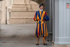VATICAN CITY, ITALY - JUNE 8, 2018 : A member of the Pontifical Swiss Guard, Vatican. Rome. VATICAN CITY, ITALY - JUNE 8, 2018 : A member of the Pontifical Swiss Stock Images