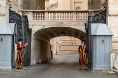 VATICAN CITY, ITALY - JUNE 8, 2018 : A member of the Pontifical Swiss Guard, Vatican. Rome. VATICAN CITY, ITALY - JUNE 8, 2018 : A member of the Pontifical Swiss Stock Photo