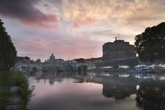 Vatican City, Rome, Italy, Beautiful Vibrant Night image Panorama of St. Peter`s Basilica. Ponte St. Angelo and Tiber River at Dusk in Summer. Reflection of royalty free stock photos
