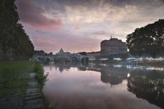 Vatican City, Rome, Italy, Beautiful Vibrant Night image Panorama of St. Peter`s Basilica, Ponte St. Angelo and Tiber River at Dus. K in Summer. Reflection of stock images