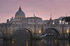 Vatican City, Rome, Italy, Beautiful Vibrant Night image Panorama. Of St. Peter`s Basilica, Ponte St. Angelo and Tiber River at Dusk in Summer. Reflection of stock image
