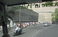 Vatican City, Rome, Italy. Crowds lineup by the Vatican City wall as they wait to get into the Vatican Stock Images
