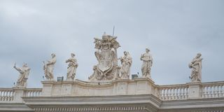 Vatican City, Rome, Italy - February 16, 2015: famous colonnade with statues of St. Peter royalty free stock photography